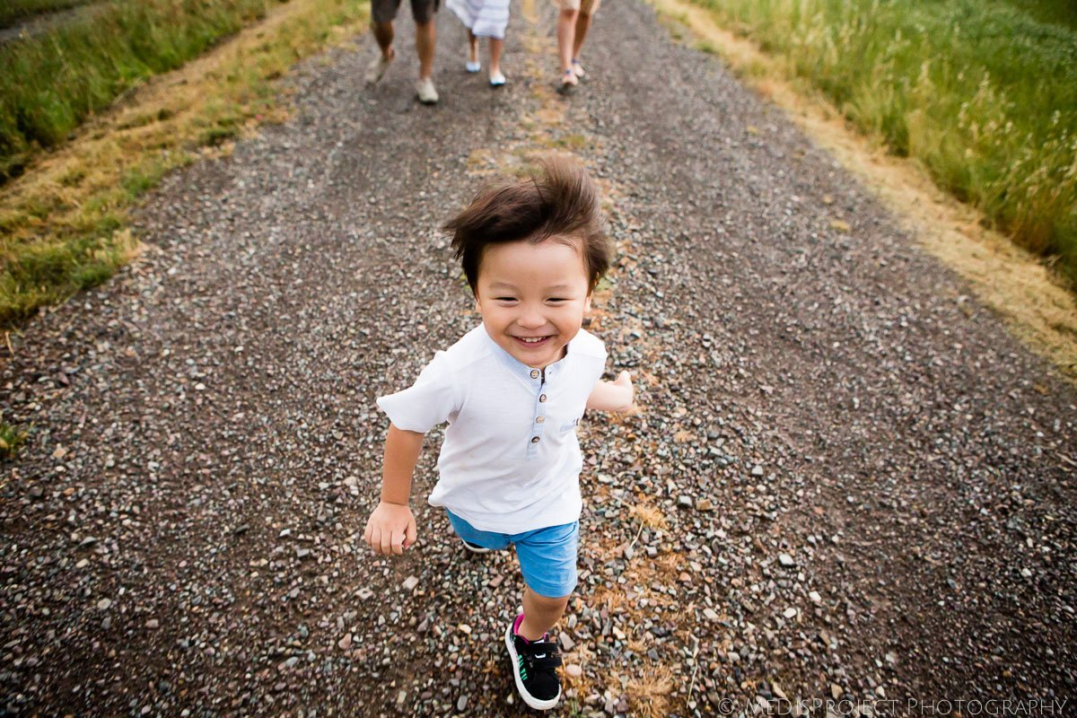 oriental little kid running and smiling
