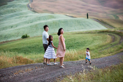 Oriental family strolling through the country roads of Tuscany