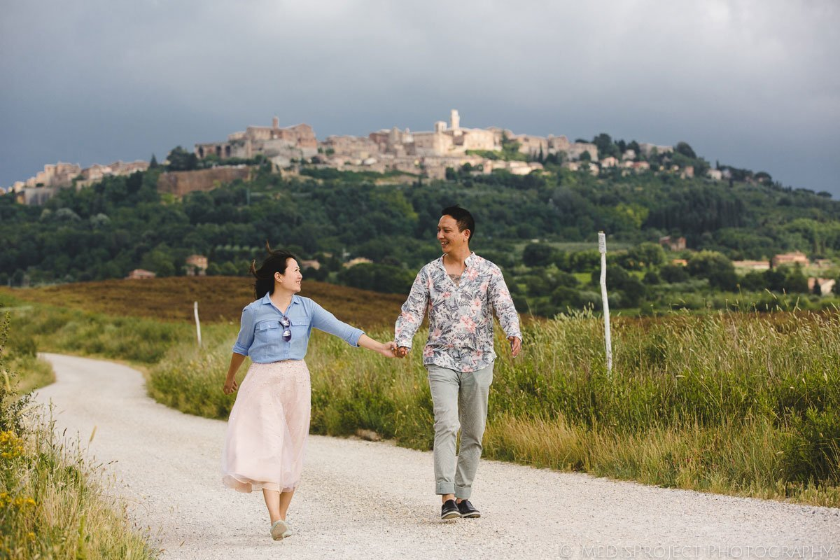 chinese couple walking through the country roads around Montepulciano