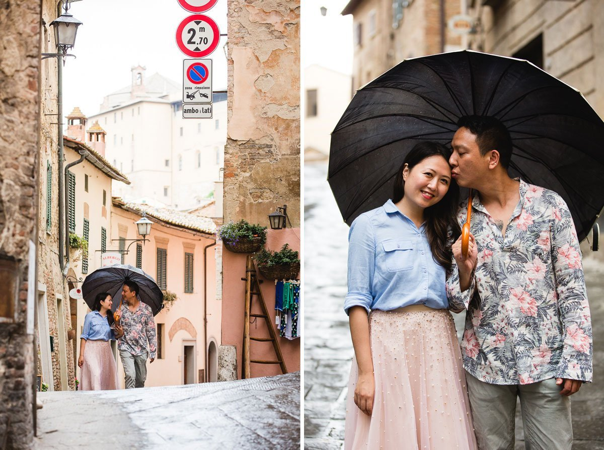 chinese couple walking through the streets of Montepulciano under the umbrella
