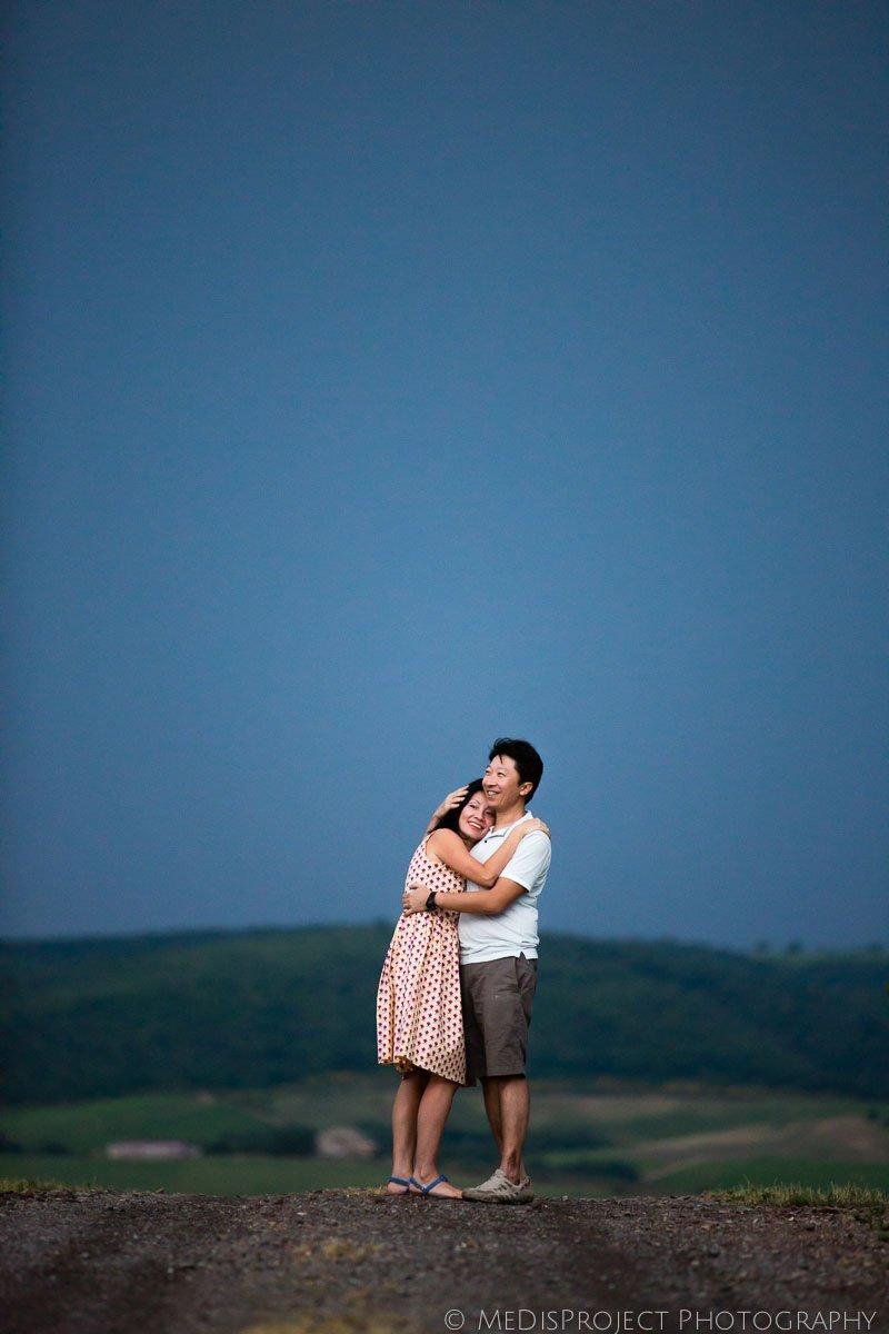Oriental parents hugging after the storm