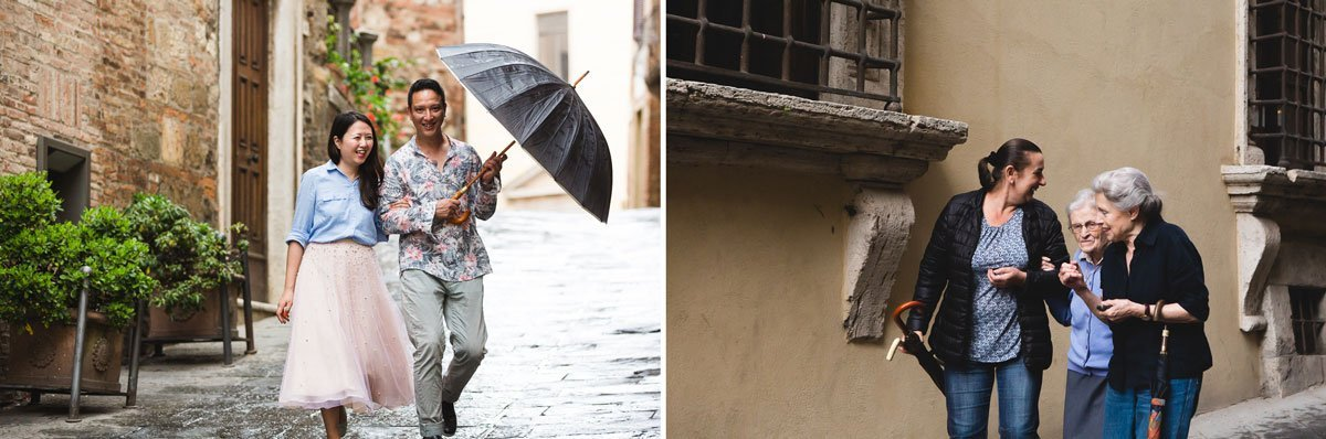 chinese couple walking through the streets of Montepulciano after a summer rain