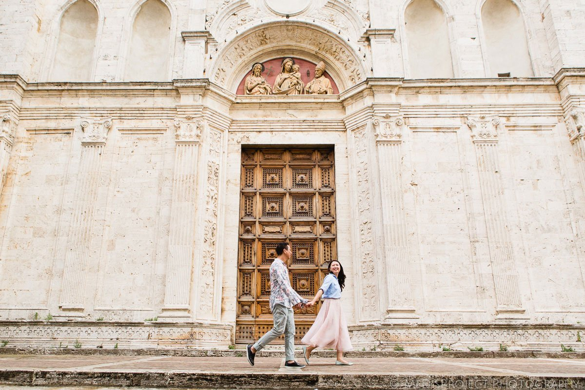 chinese couple walking through the streets of Montepulciano