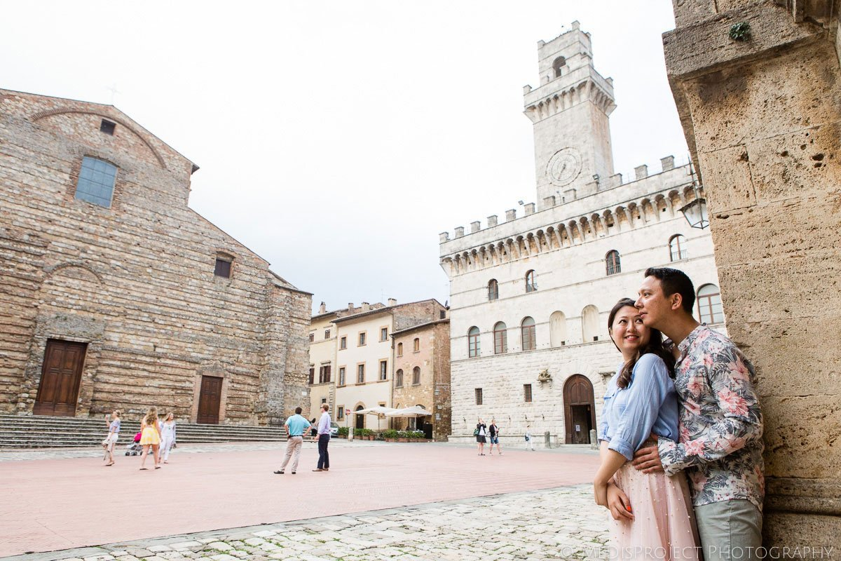 chinese couple in the main piazza of Montepulciano