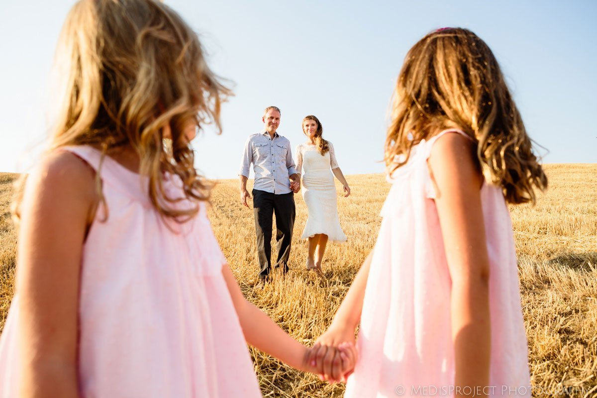 family portrait on a stubble field in Italy
