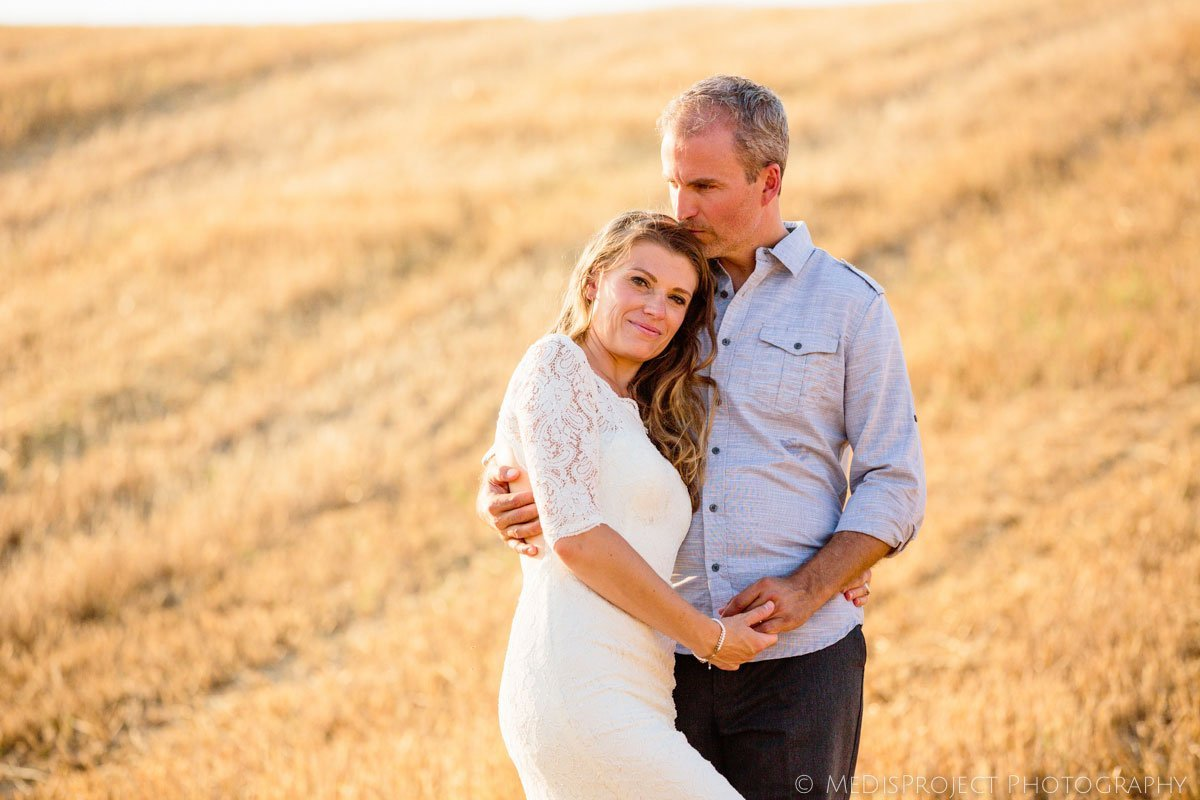 romantic couple on a stubble field in Italy