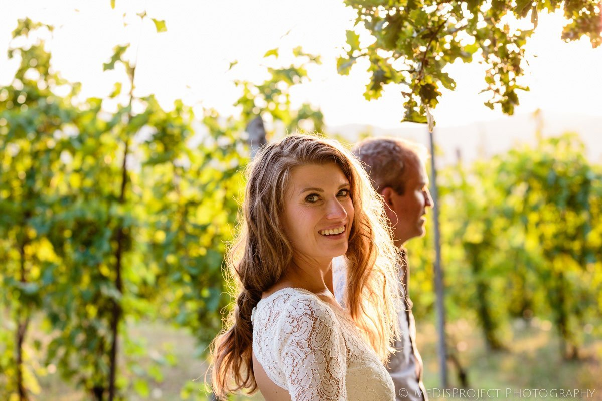 a romantic photo shoot in the vineyards with a beautiful couple in their fourties