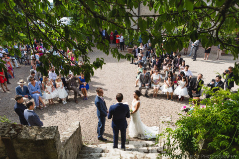 moments of an outdoor wedding ceremony in Borgo Pignano, Tuscany