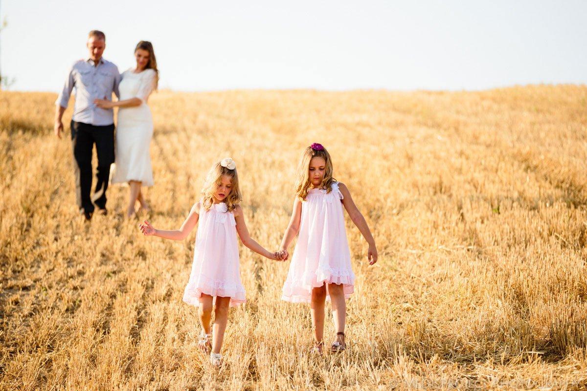 family portrait on a stubble field