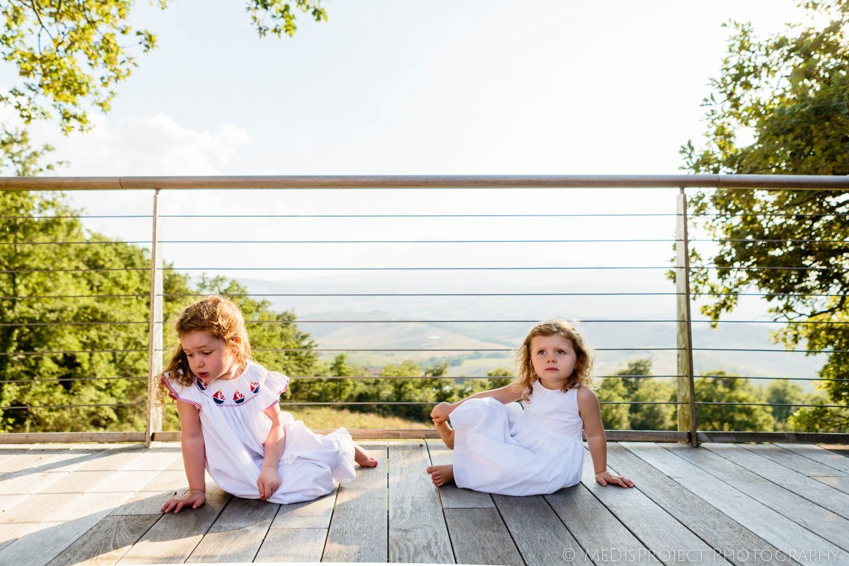 two little girls playing on the floor at Inspirato's Tenuta Monticelli
