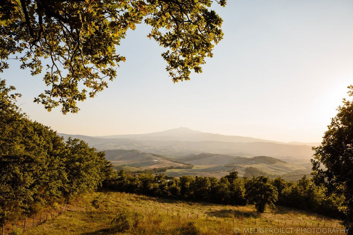 view of Mount Cetona and surrounding hills at sunset from Inspirato's Tenuta Monticelli