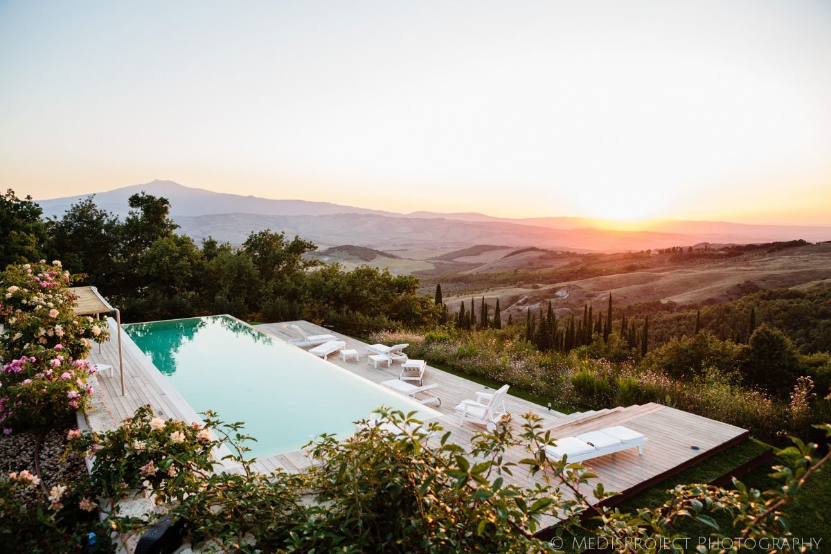 view of Inspirato's Tenuta Monticelli with pool and sunset