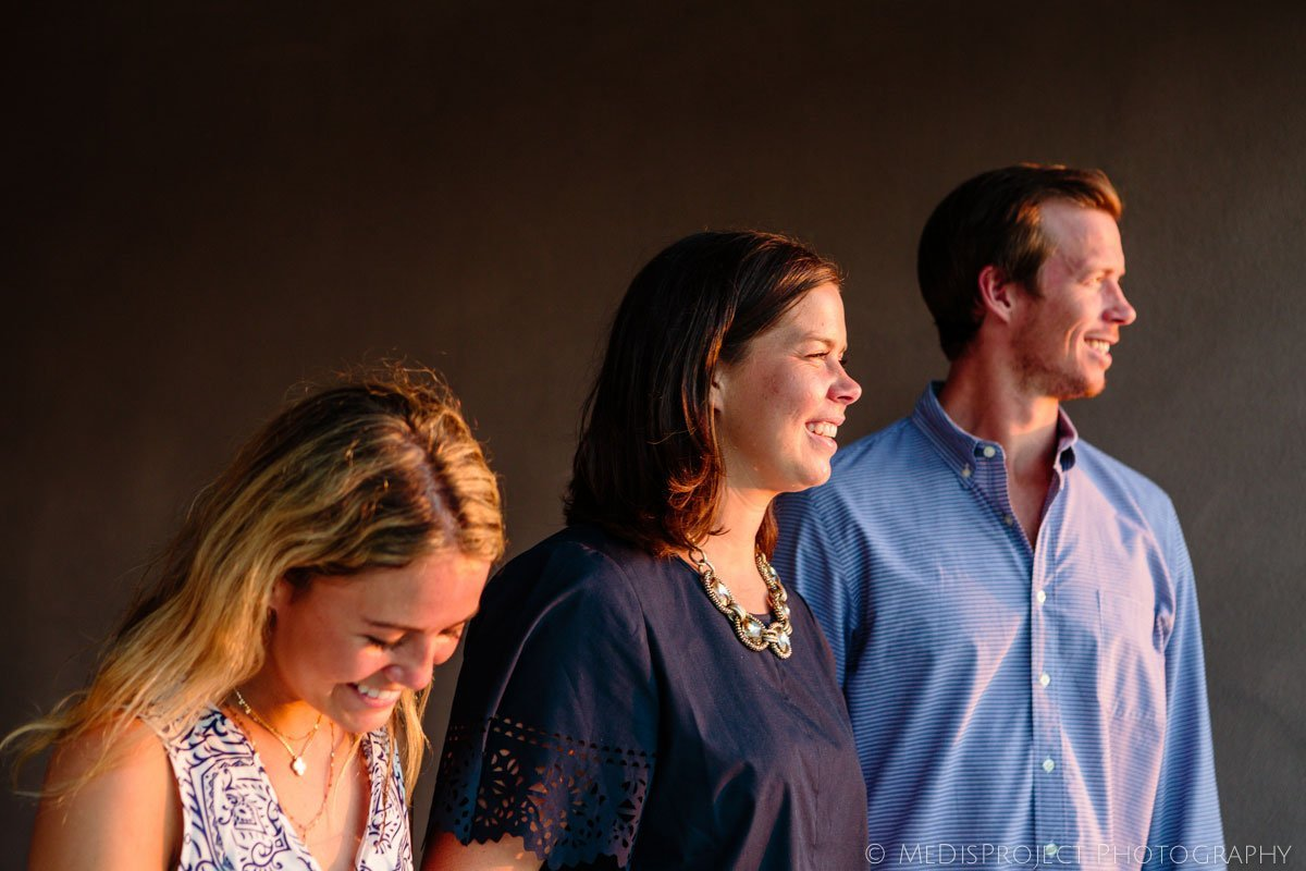 siblings profiles with golden light