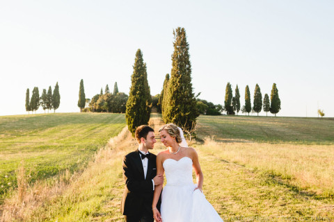 Bride and groom walking in a famous movie Gladiator's set in Tuscany