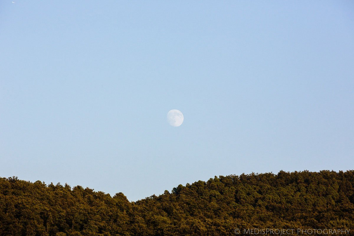 full moon rising over the Tuscan hills