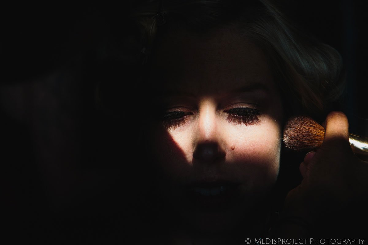 lights and shadows on the bride's face while doing the make up