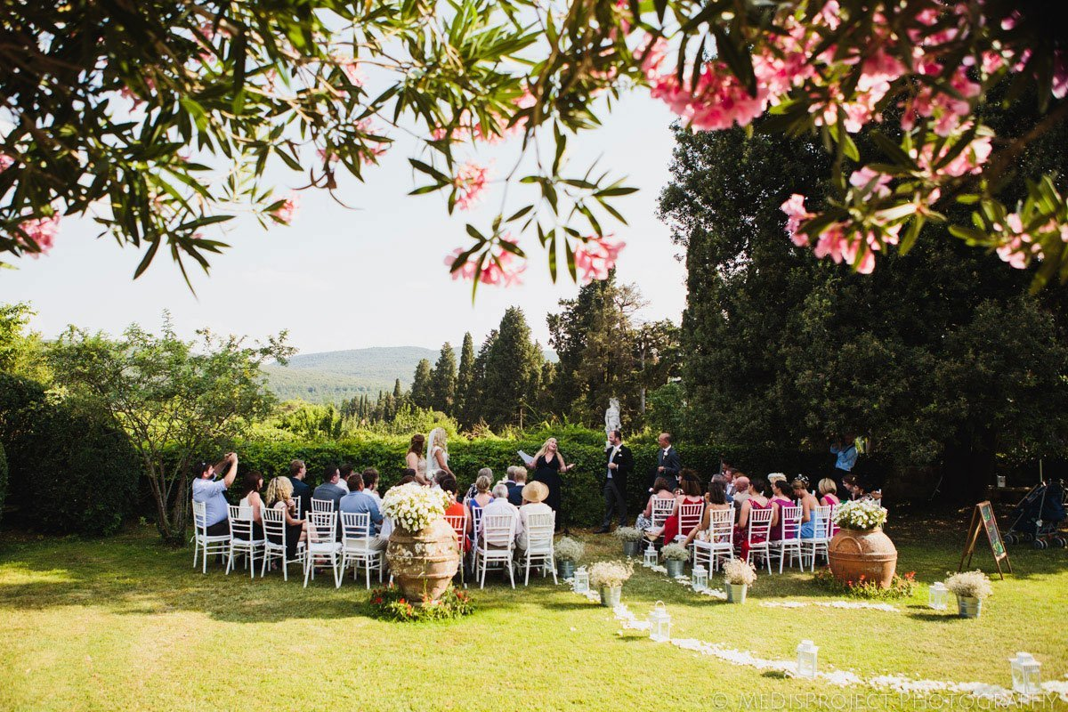 outdoor wedding ceremony in Borgo Stomennano's garden, Tuscany