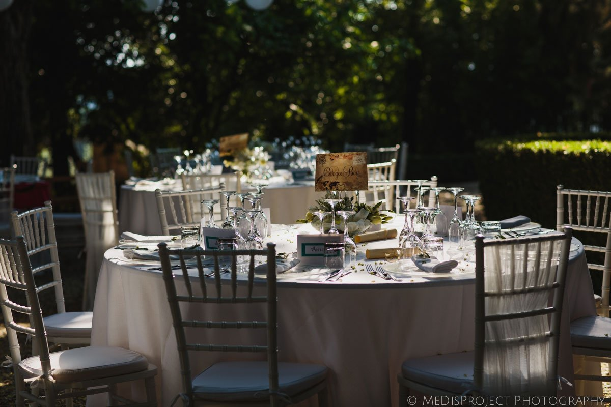 table setting for a romantic outdoor wedding dinner in Stomennano
