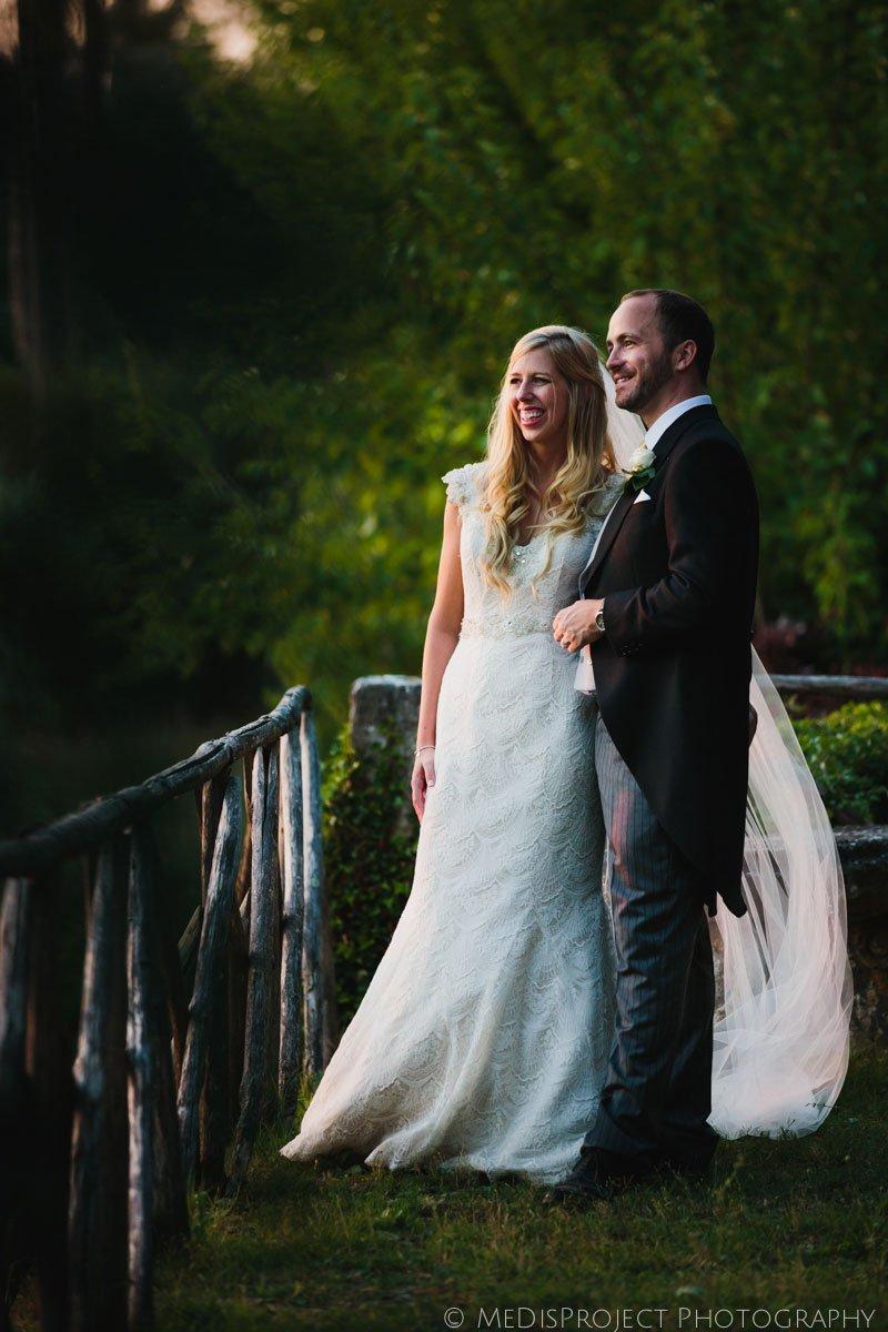 bride and groom standing in dusk golden light