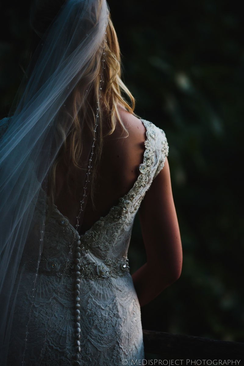 bride's gown back detail in dusk golden light