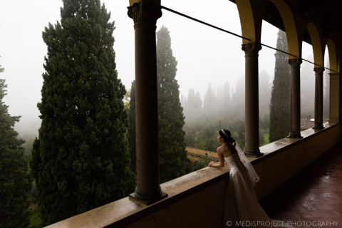 Bride standing on Villa Agape's turret on a foggy day