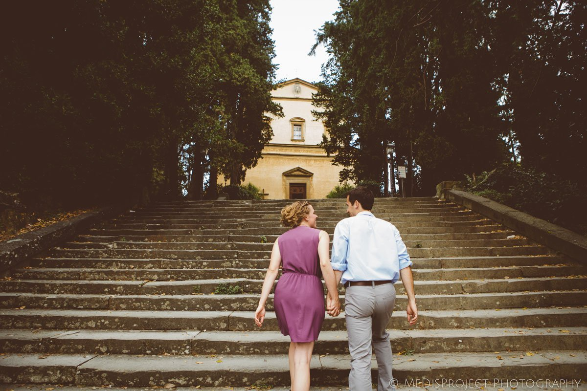 couple climbing an old stairway in Florence