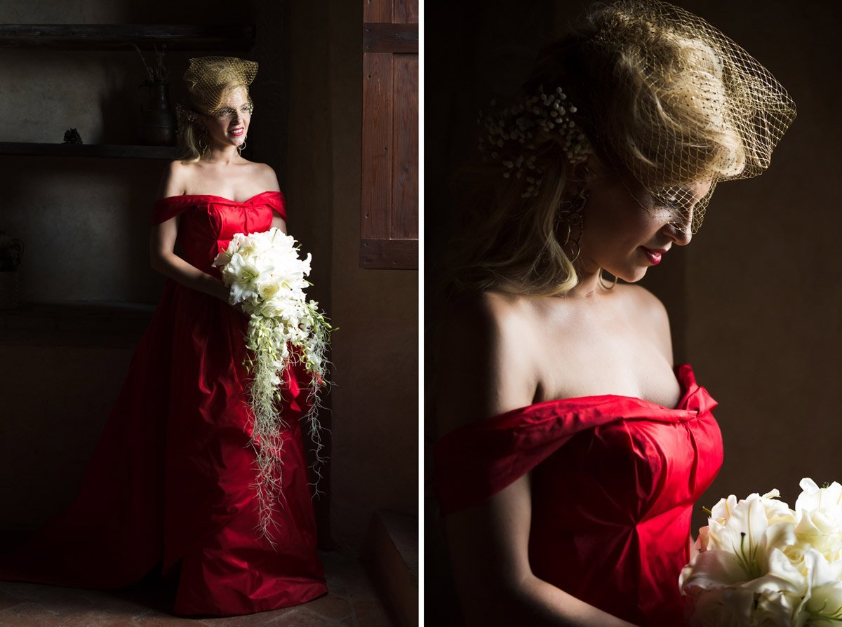 Beautiful blonde bride dressed in a original bright red gown and white flowers