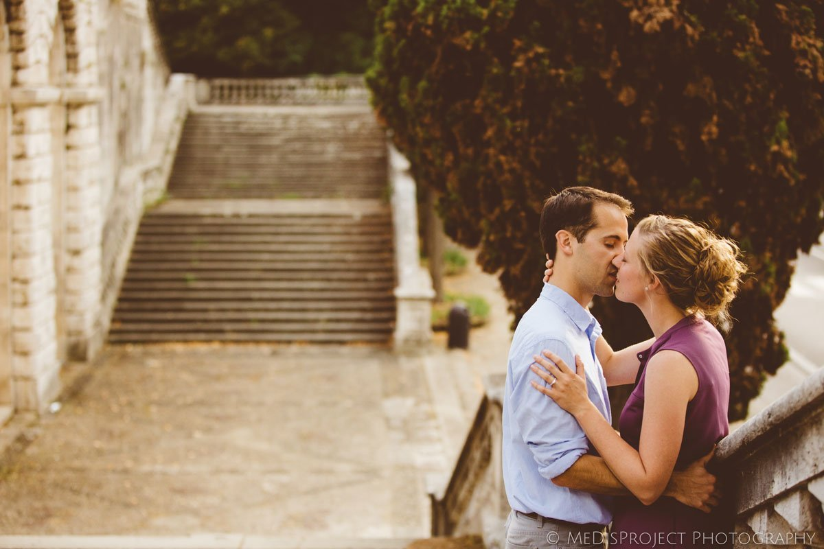 young lovers kissing in a romantic stairway of Florence