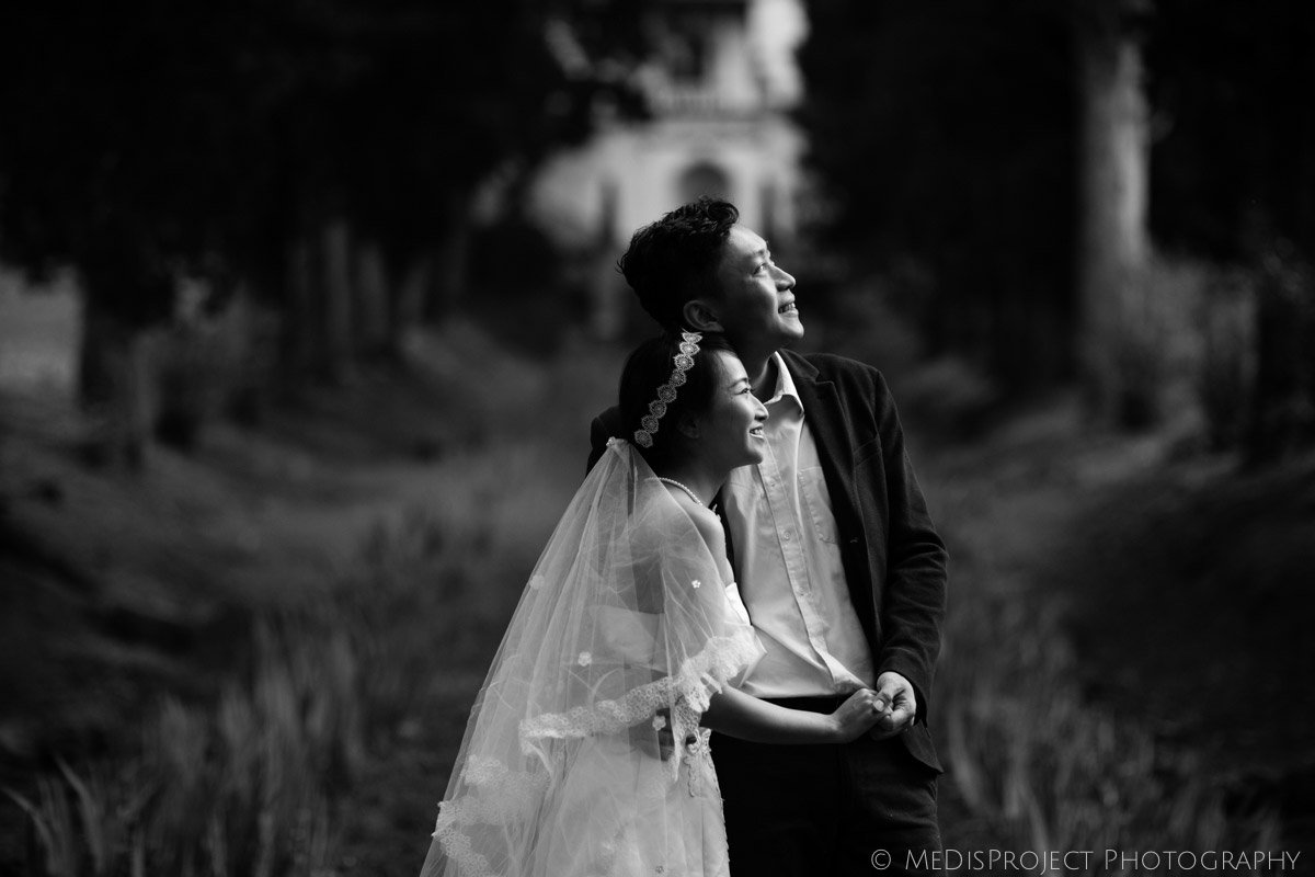 black and white photo of a bride and groom in cypress boulevard in Villa Agape