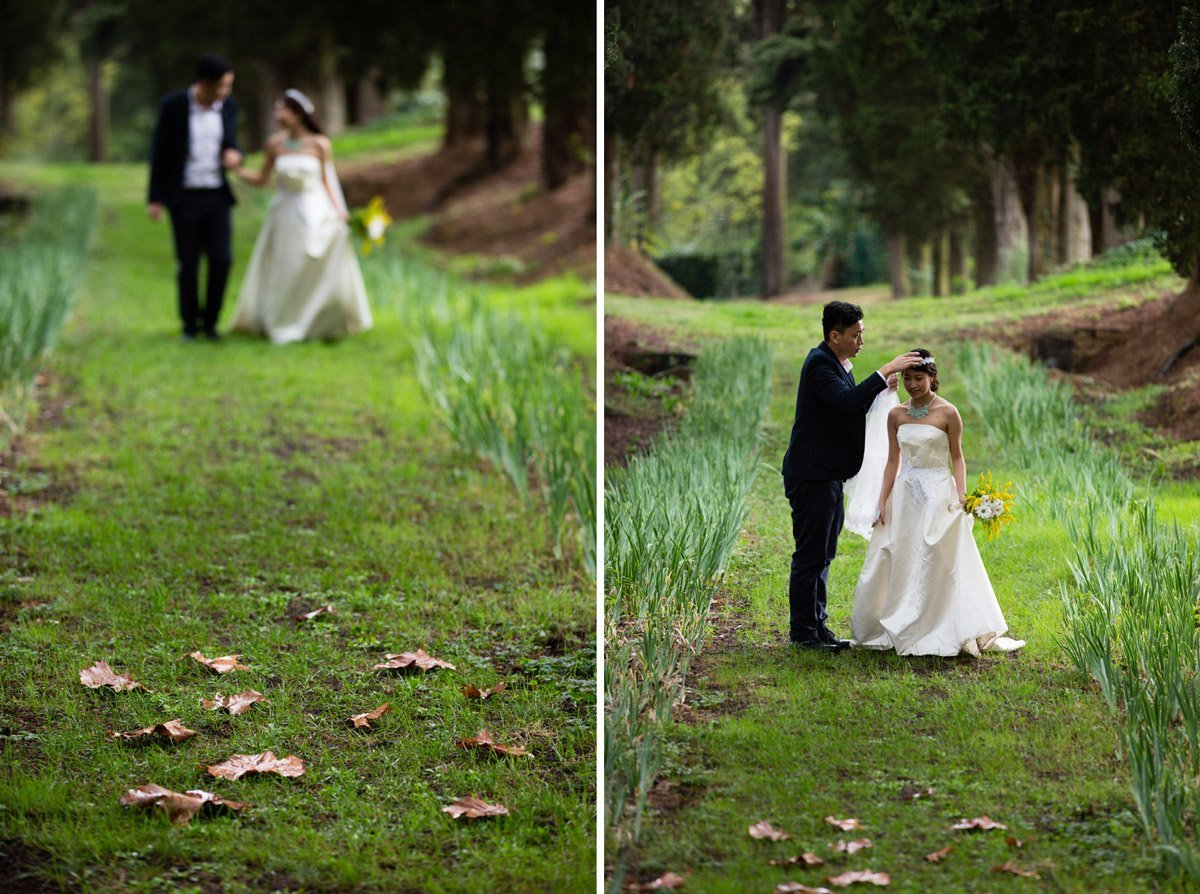 bride and groom walking through a cypress boulevard in Villa Agape