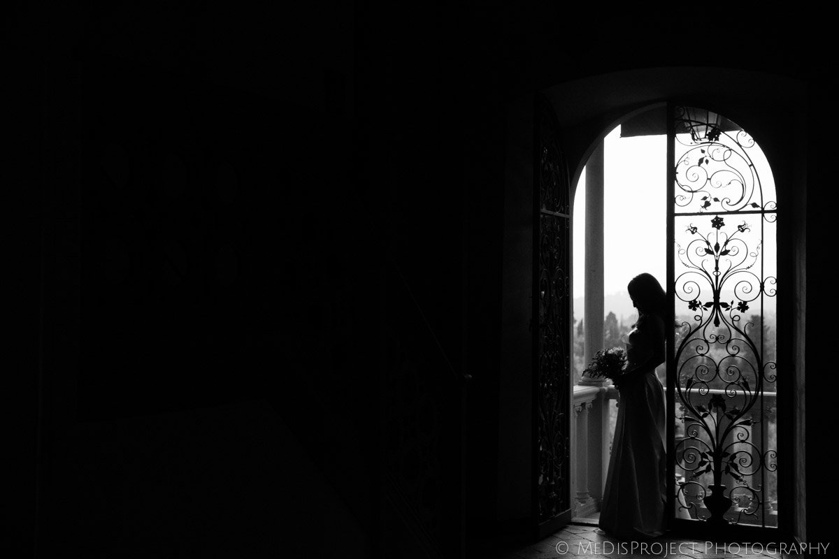 bride silhouette standing by a wrought iron doorway in Villa Agape