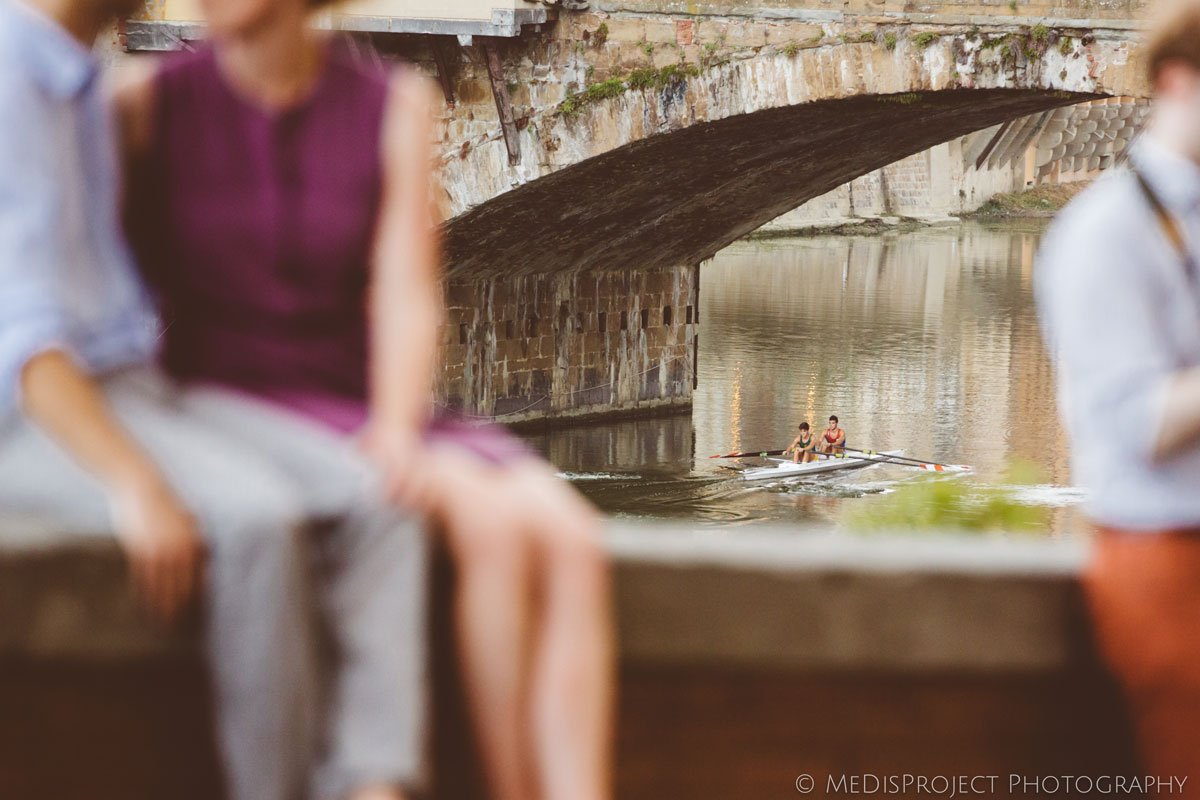 rowers next to Ponte vecchio in Florence