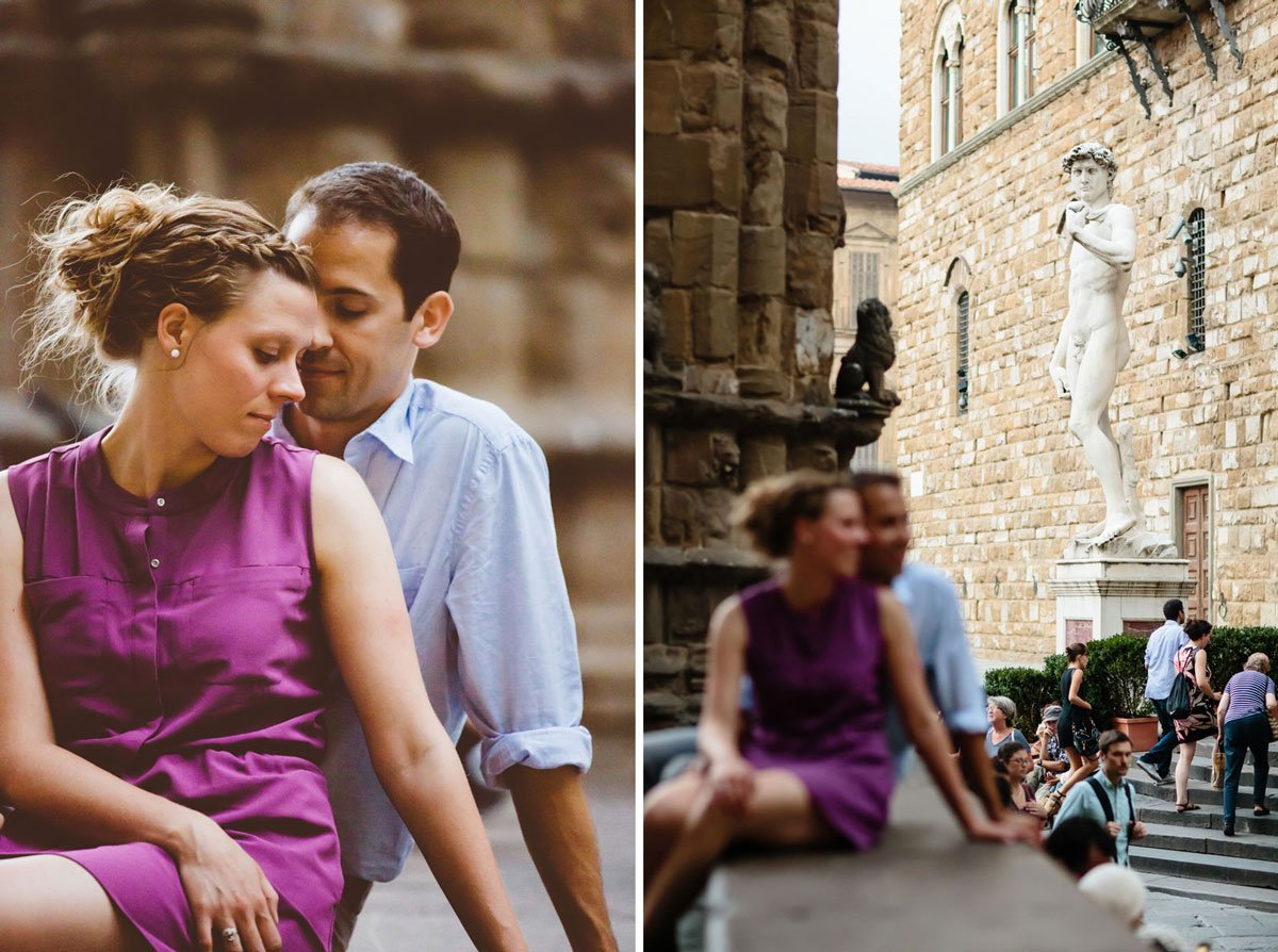 just engaged couple next to Michelangelo's David statue in Piazza della Signoria, Florence
