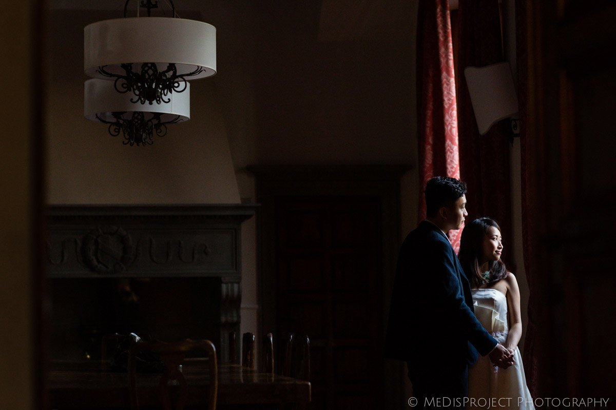 Couple from Hong Kong standing in the dining room of Villa Agape Florence