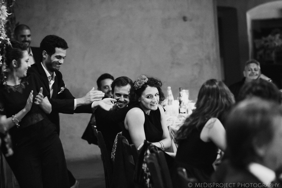 black and white funny moments during an Italian wedding reception
