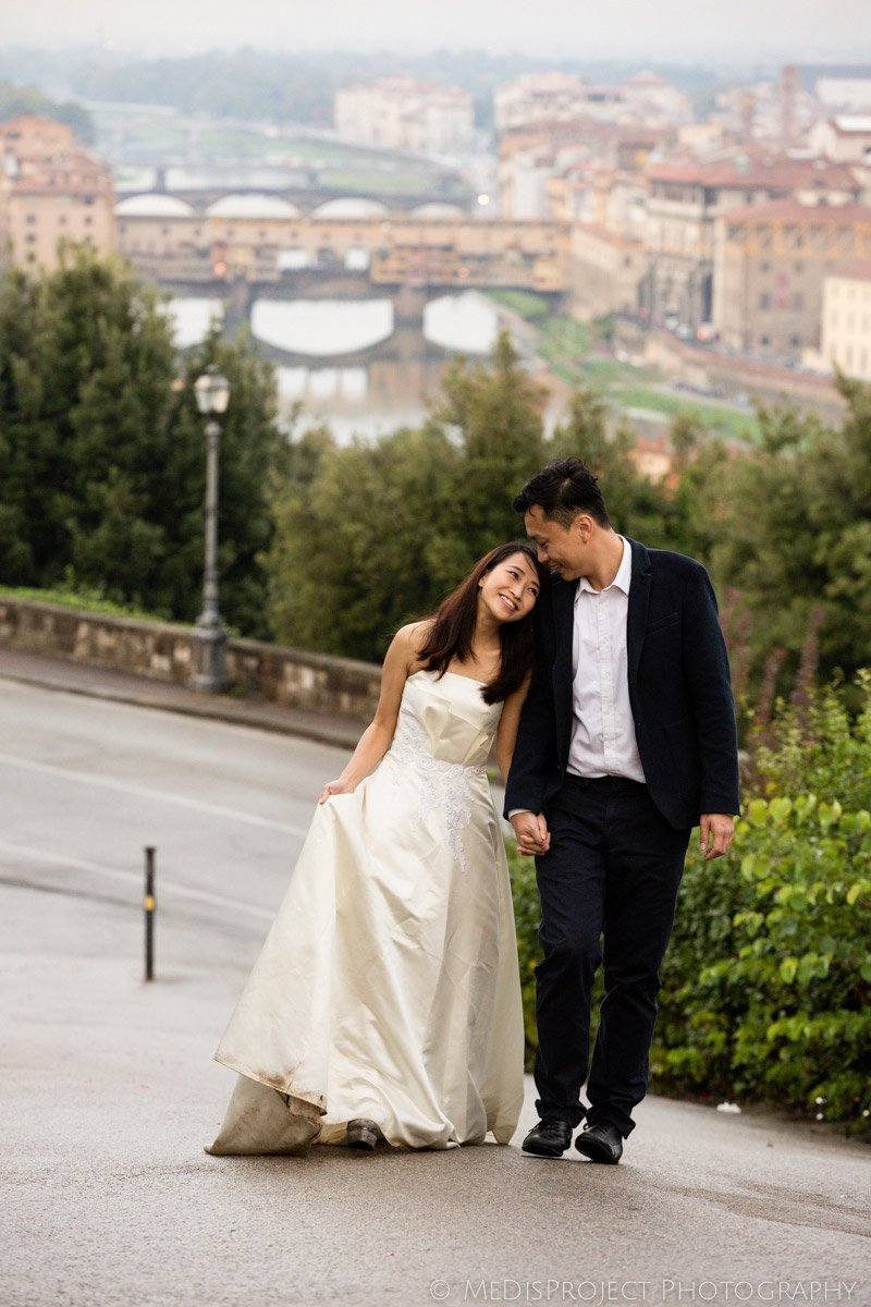Chinese couple walking up to Piazzale Michelangelo in Florence