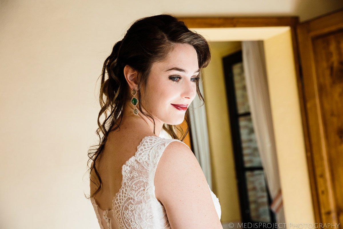 stunning brunette bride's portrait just before the wedding ceremony