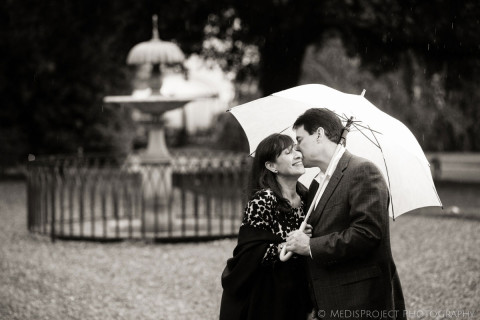 wedding anniversary photo shoot under the umbrella during the rain at the Four Seasons Hotel in Florence