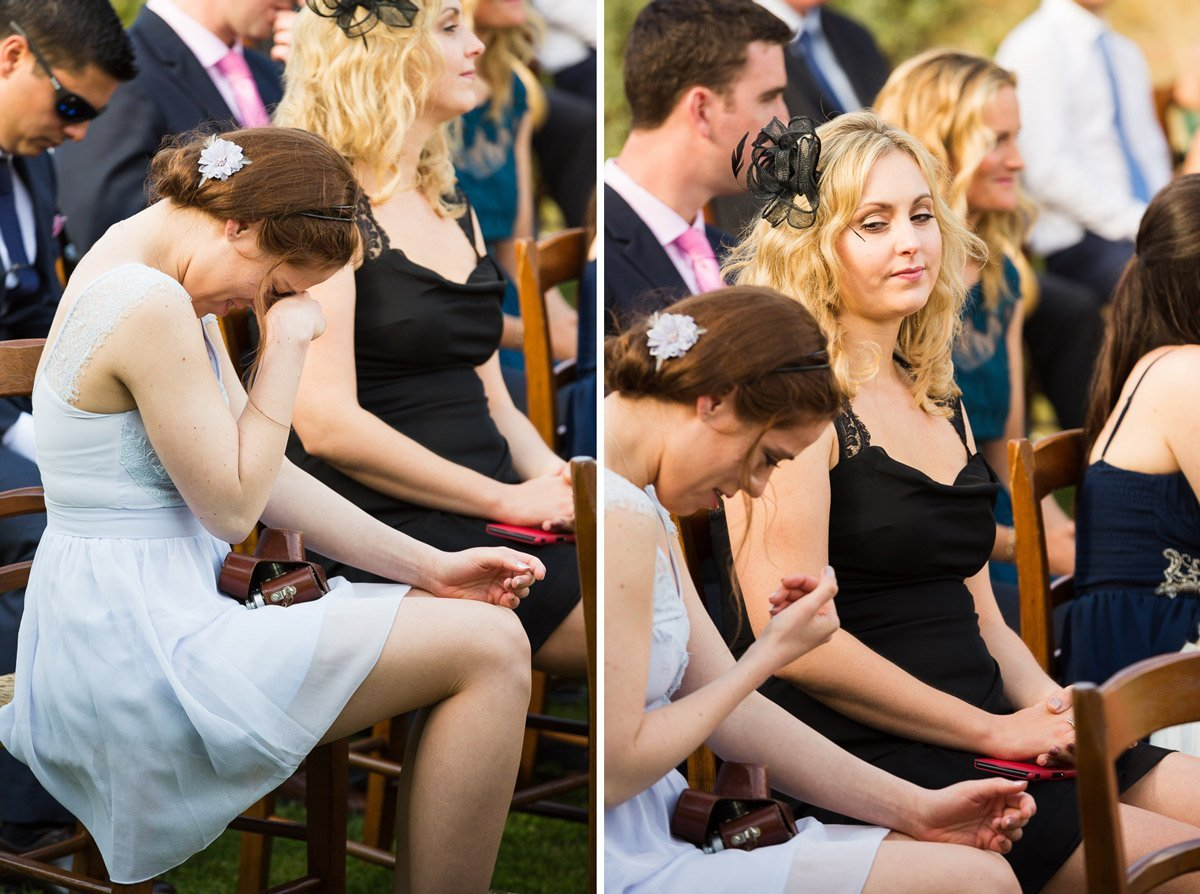 ladies laughing and crying during an outdoor wedding ceremony at Casa Cornacchi, Bucine