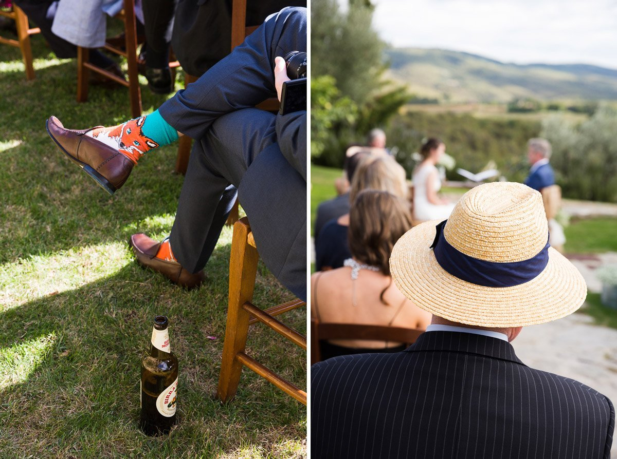 funny guest with foxy sox and beer watching an outdoor wedding ceremony at Casa Cornacchi, Bucine