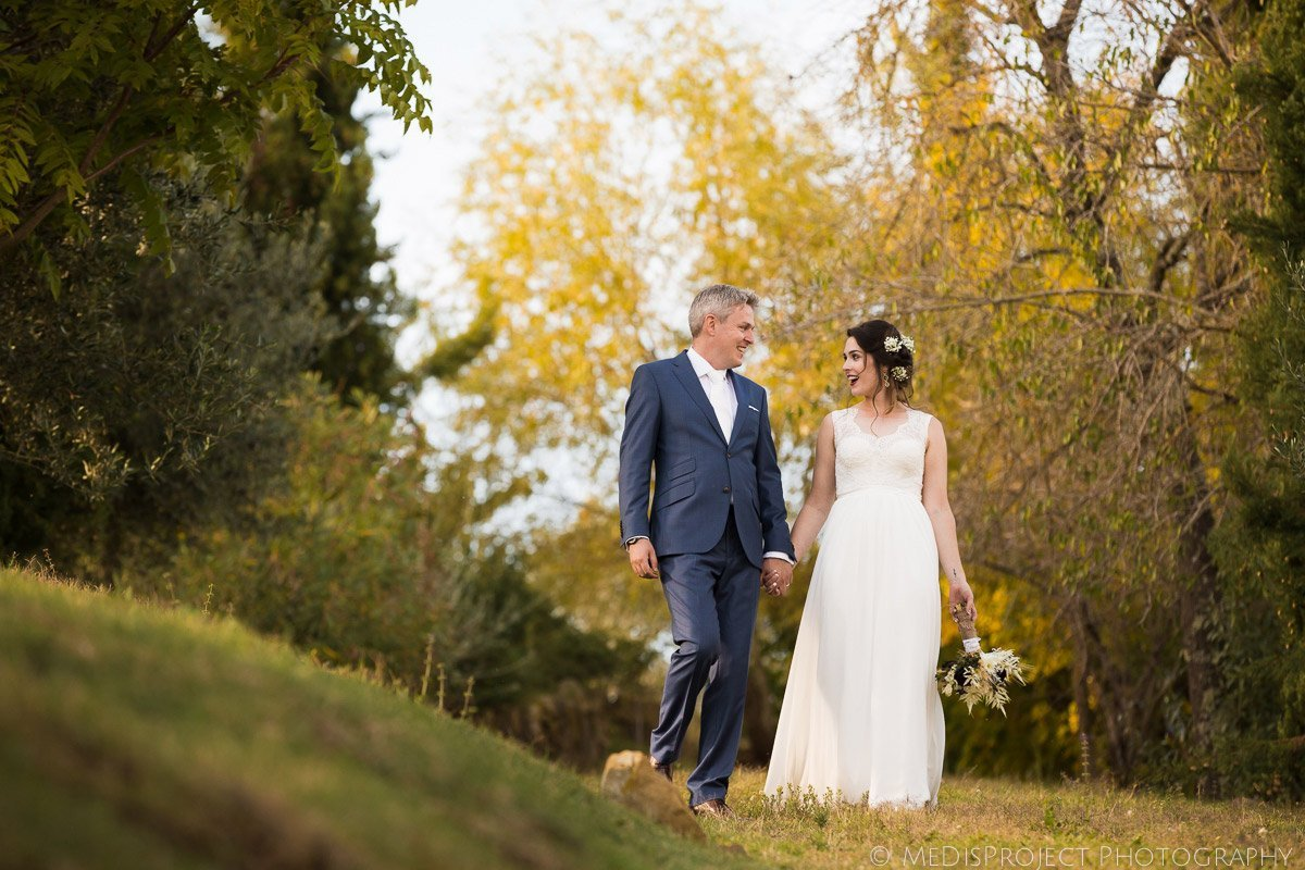 bride and groom walking in the garden at Casa Cornacchi