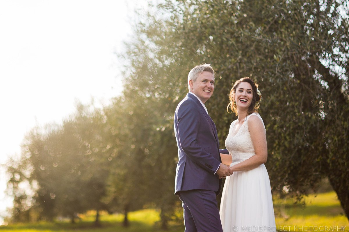 bride and groom in a Tuscan olive grove at sunset