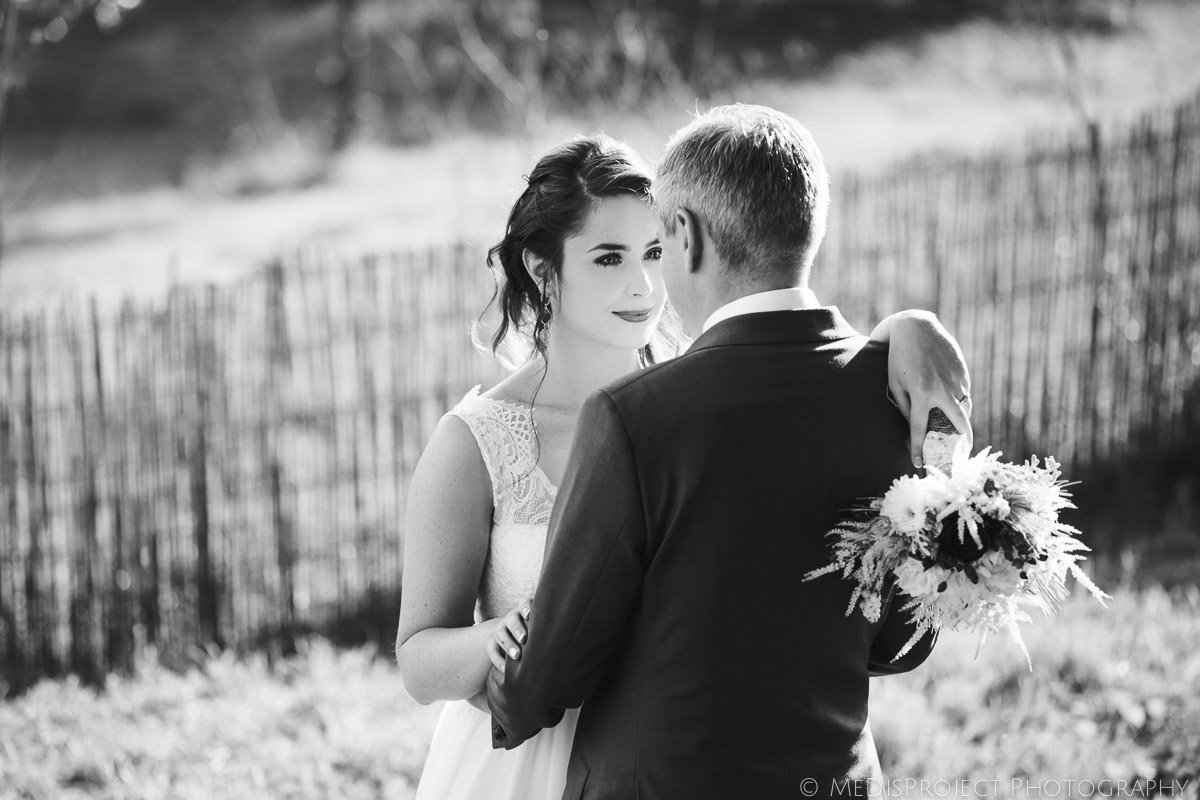black and white image of a stunning Irish bride and her charming groom