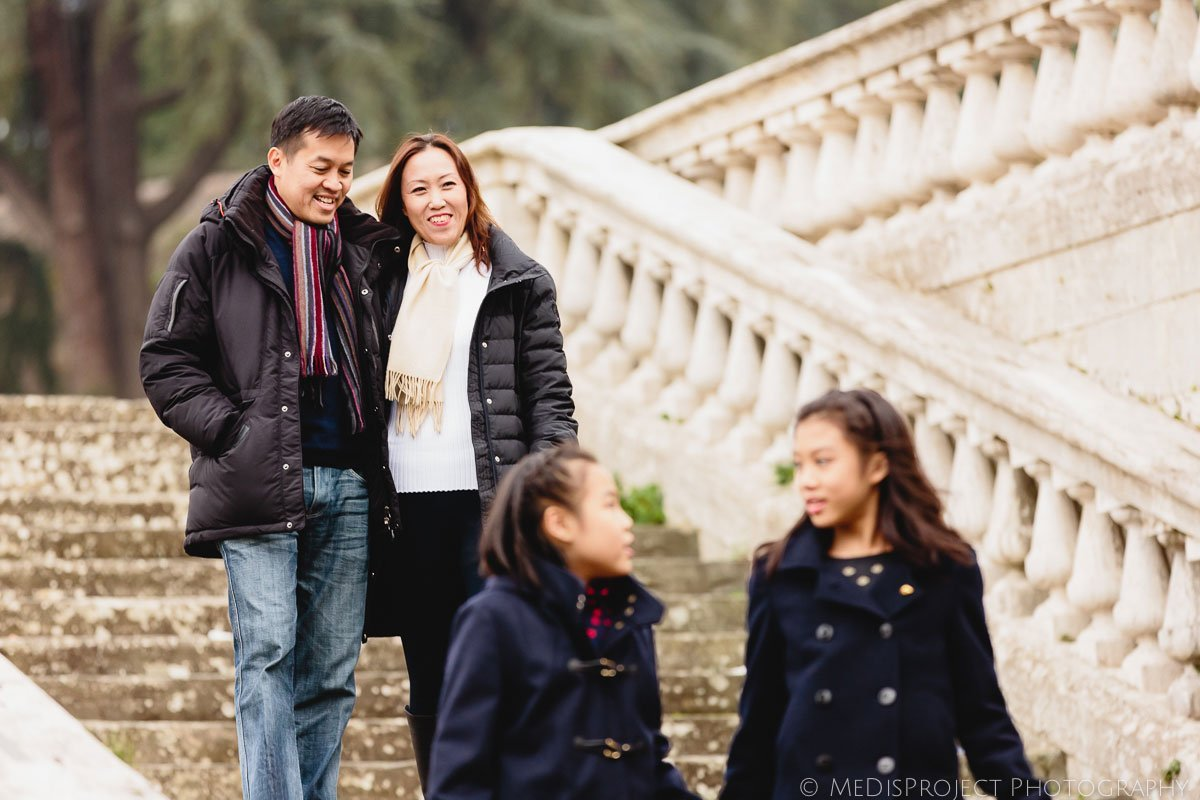 oriental family on San Miniato al monte old stairway