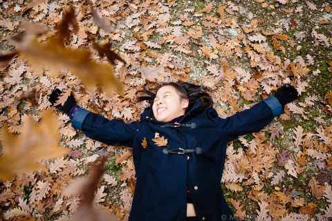 Playing with dead leaves during a family photo session