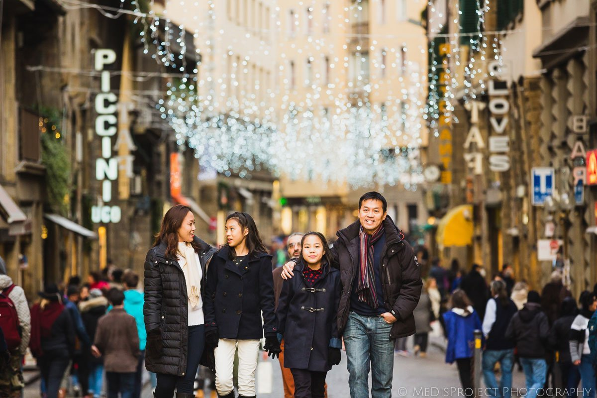 Oriental family vacationing during Christmas time in Florence
