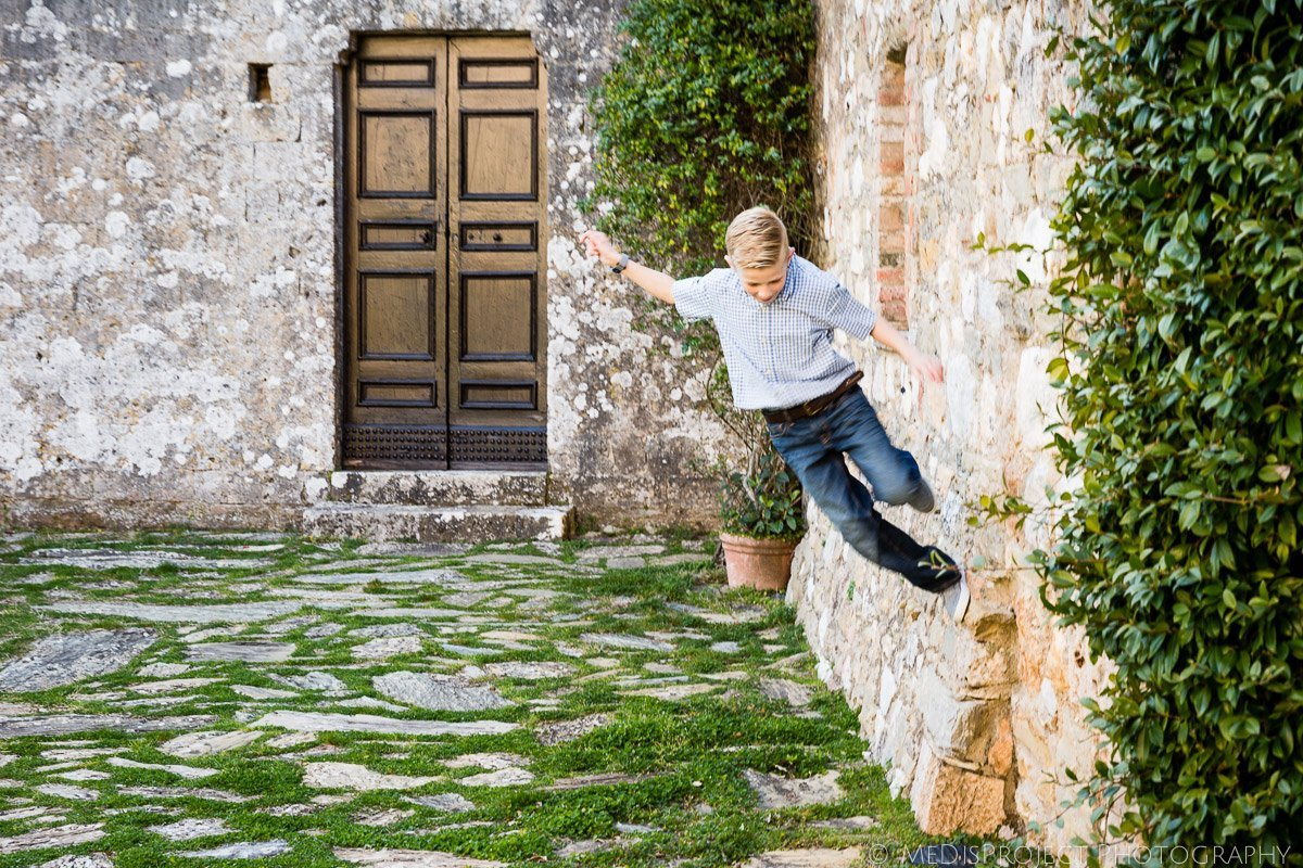 kids playing in the yard of Villa Bellezza by Inspirato