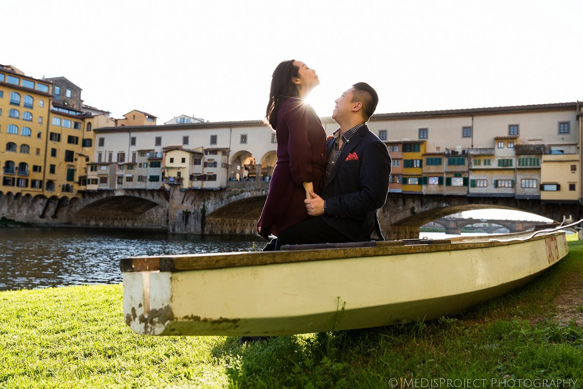 couple celebrating their anniversary next to Ponte Vecchio in Florence