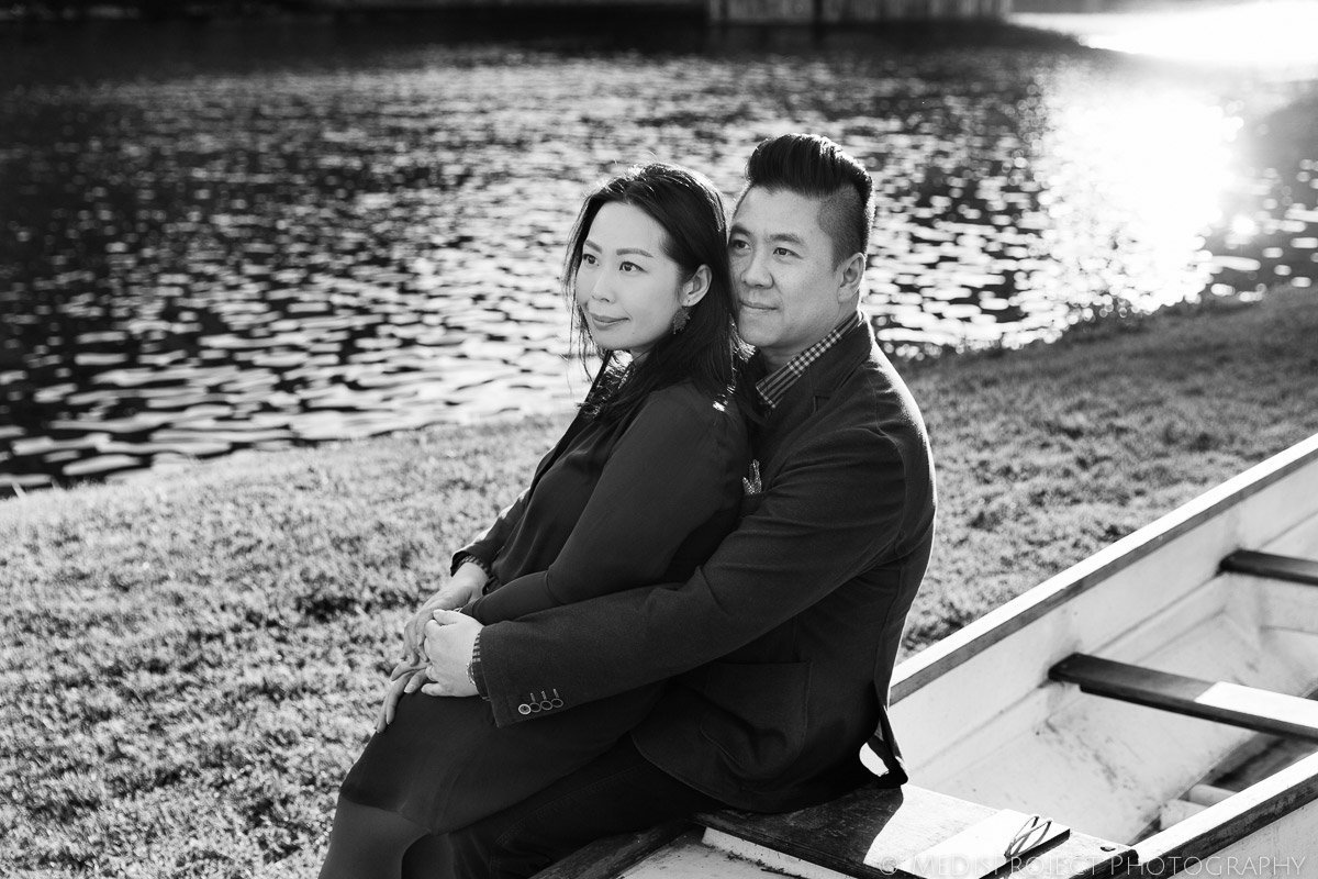 black and white photo of asian couple next to Arno river