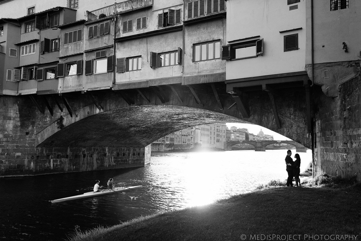 black and white silhouette of a couple under the Old Bridge in Florence